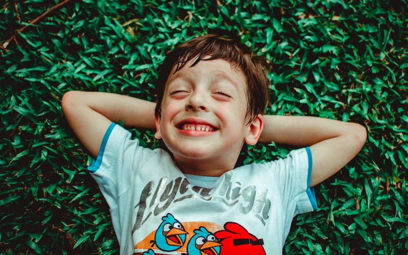 child smiling, brush teeth, Darlene Sand Wall DMD, pediatric dentistry