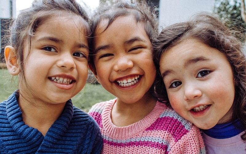 children smiling after dentist visit