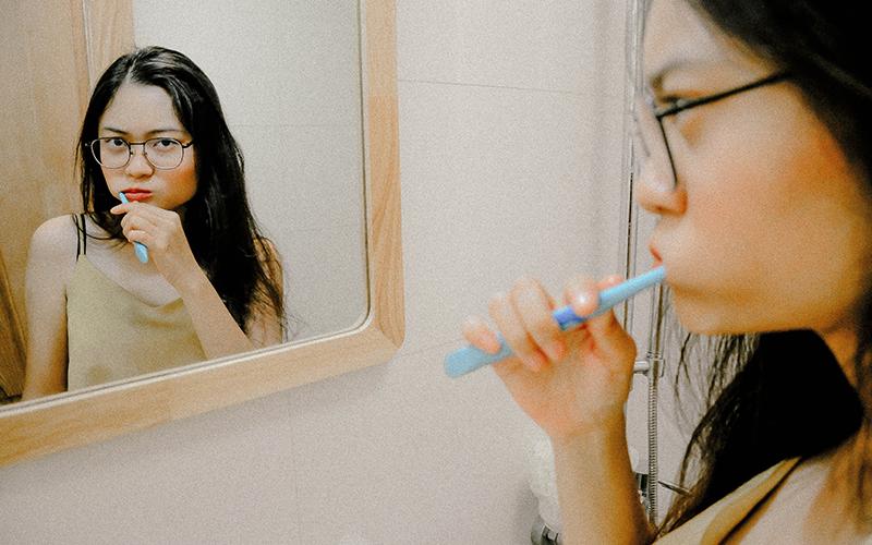 gum recession, woman, brushing teeth, Darlene Sand Wall DMD, dentistry